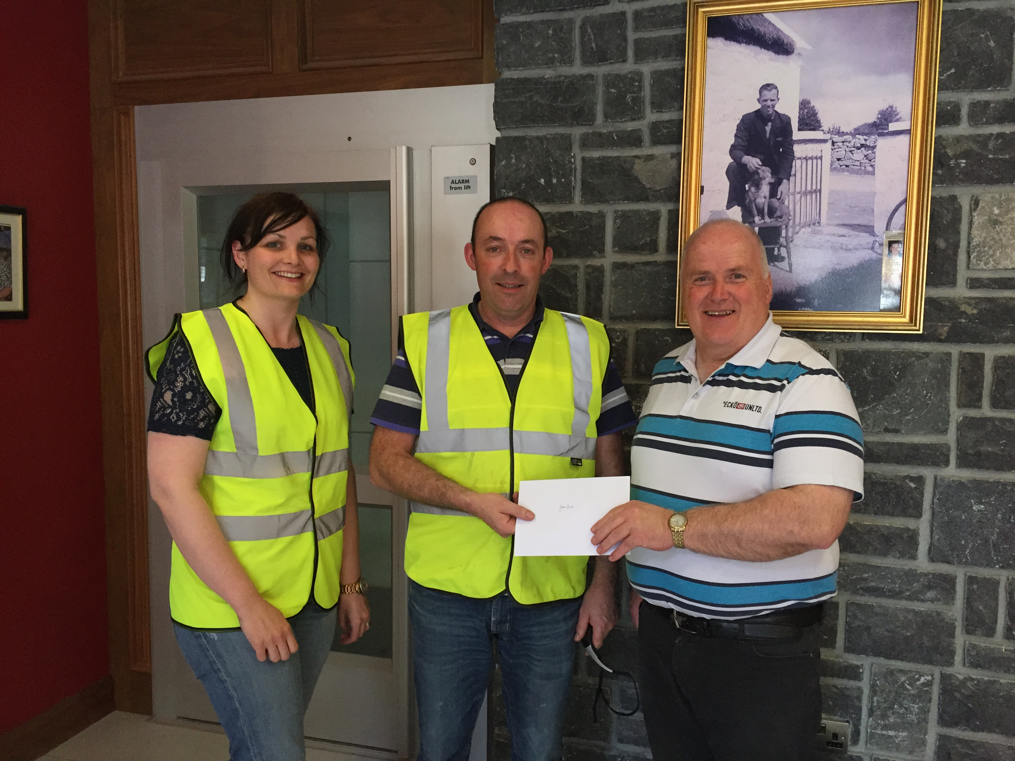 Billy McGrath presenting James Burke with a fuel voucher